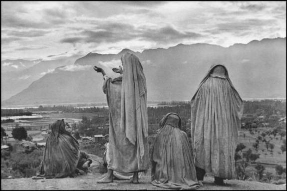INDIA. Kashmir. Srinagar. 1948. Muslim women on the slopes of Hari Parbal Hill, praying toward the sun rising behind the Himalayas.