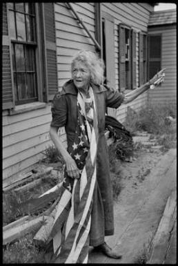 "USA. Massachusetts. Cape Cod. July 4th, 1947. Independence Day. ""This woman explained to me that the flagpole over her door was broken but 'on such a day as this, one keeps one's flag on one's heart.'"" I felt in her a touch of the strength and robustness of the early American pioneers'."