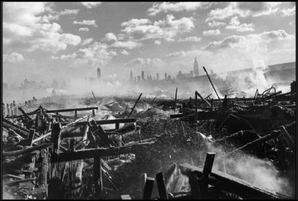 UNITED STATES. New York City. 1947. Fire in Hoboken, facing Manhattan.