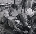 Edmund Hillary reads his mail after coming back down from the summit of Everest