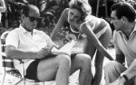 Terrance Young reads to Ursula Andress and Sean Connery