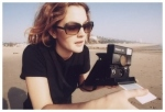 Drew Barrymore with a Polaroid