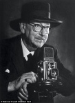 Edward Chambre Hardman with the Rolliflex camera he used to capture many of his iconic images of Liverpool in the mid 20th century