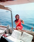 Jacqueline Kennedy Onassis with an SLR