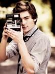 Zac Efron with a Polaroid