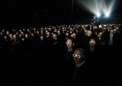 Members of the audience wear 3d glasses while watching German electronic band Kraftwerk perform with a 3d stage set at the Tate Modern in London