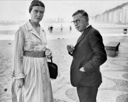 Simone de Beauvoir and Jean-Paul Sartre take a turn on the beach.