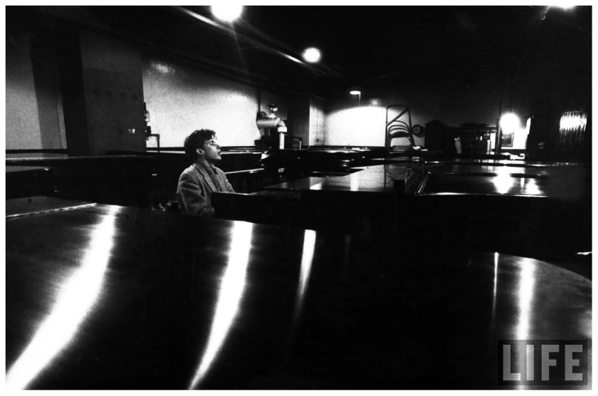 glenn-gould-_singing_-as-he-samples-the-action-tone-of-a-piano-at-the-steinway-warehouse-before-choosing-the-final-one-for-his-e28098bach-goldberg-variations_-recording-sessio