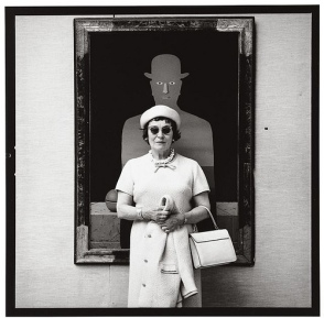 Wolleh, Lothar (1930-1949) - 1967 Georgette Magritte, Brussels. Georgette Magritte standing in front of René's The King's Museum (Le Musee du roi) (1966)