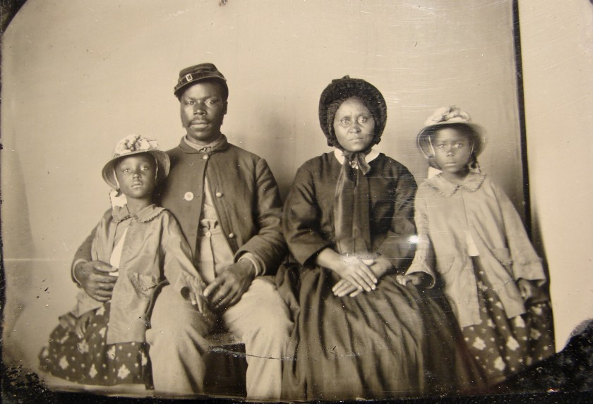Unidentified_African_American_soldier_in_Union_uniform_with_wife_and_two_daughters_-_no_frame