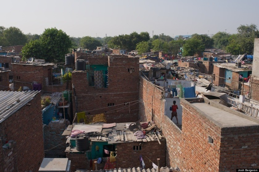 A boy on one of the many layered rooftops.