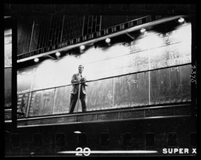 """Unidentified man standing in front of a """"Trade"""" board on which he records a """"Market Score"""" at the Chicago Board of Trade"""
