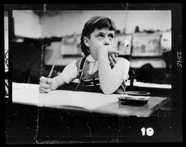 Young girl seated at desk in classroom in Chicago, Illinois