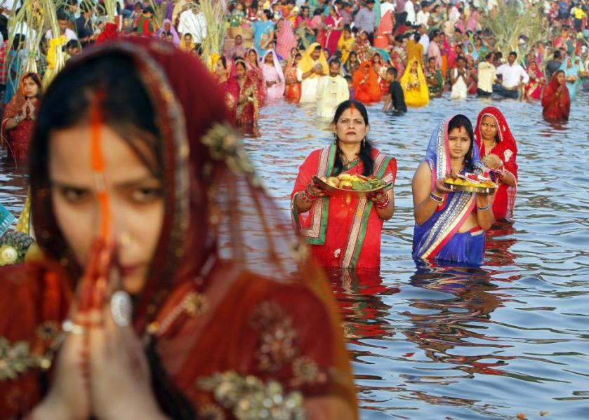 Women worship the Sun god Surya in the waters of the Sun lake during the Hindu religious festival of Chatt Puja in Chandigarh