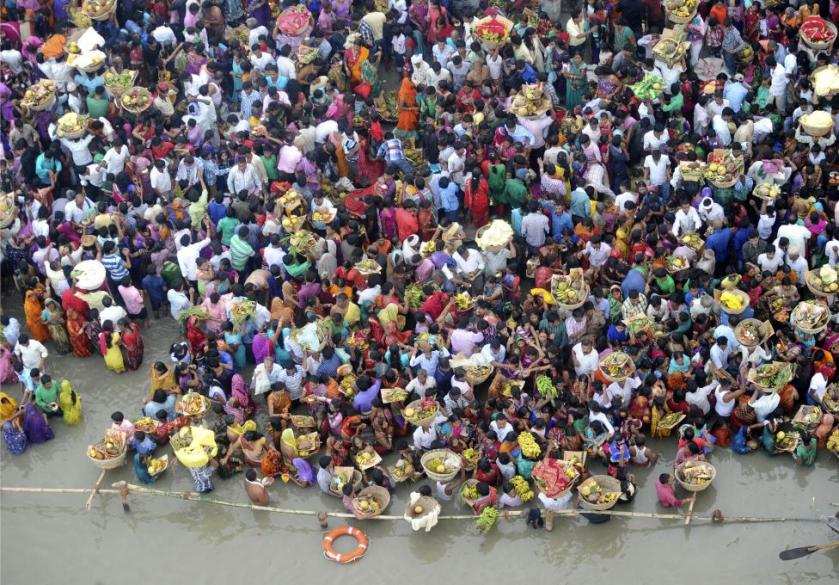 Hindu devotees gather to worship the Sun god Surya on the banks of the Ganges river during the Hindu religious festival of Chatt Puja in Patna