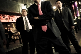 Members pose in the streets of Kabukicho, the red light district in the heart of Shinjuku, Tokyo, Japan. By always wearing tailored suits, the Yakuza attempt to spread an image of decency and conformity. But the underlying tension unmistakibly remains. Obvious influences are American gangster icons from the early 20th century, like John Dillinger - 2009