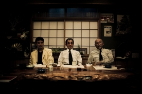 The three highest ranking bosses of the family - the Godfather in the centre - pose for a portrait during a traditional dinner at a restaurant in Kabukicho, Tokyo - 2009