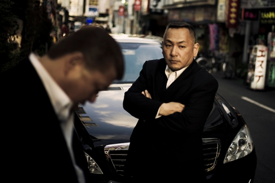 Souichirou and a friend standing in front of the Godfather's car in the streets of Kabukicho, keeping an eye out - 2010