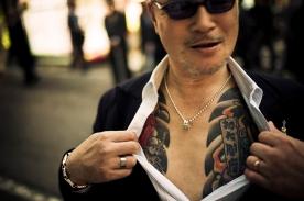 Yakuza street fighter aggressively showing off his tattoo in Kabukicho, Shinjuku, Tokyo - 2010