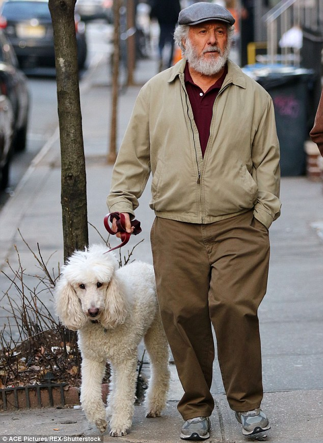 He looks ruff Dustin Hoffman sported a bushy beard as he walked a dog on the set of The Meyerowitz Stories