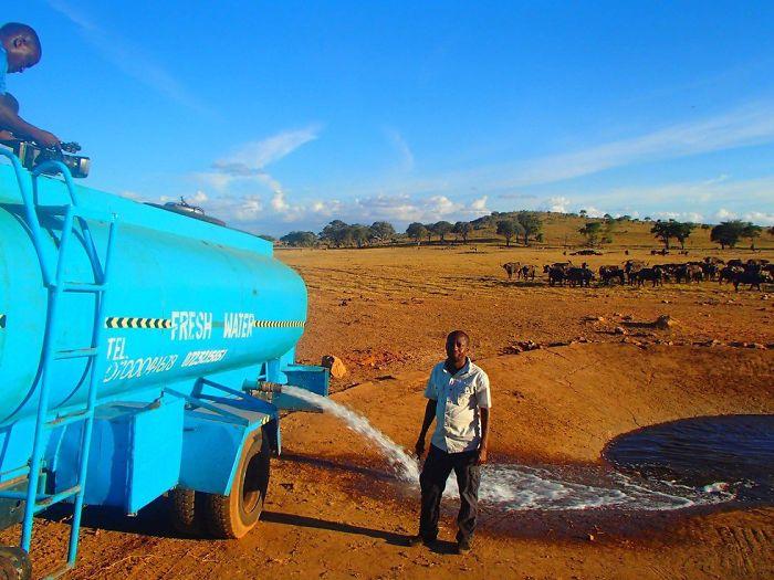 man-brings-water-wild-animals-kenya-1-58aac6da05dba__700